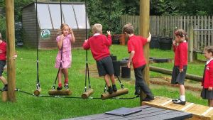 children on stepping frame